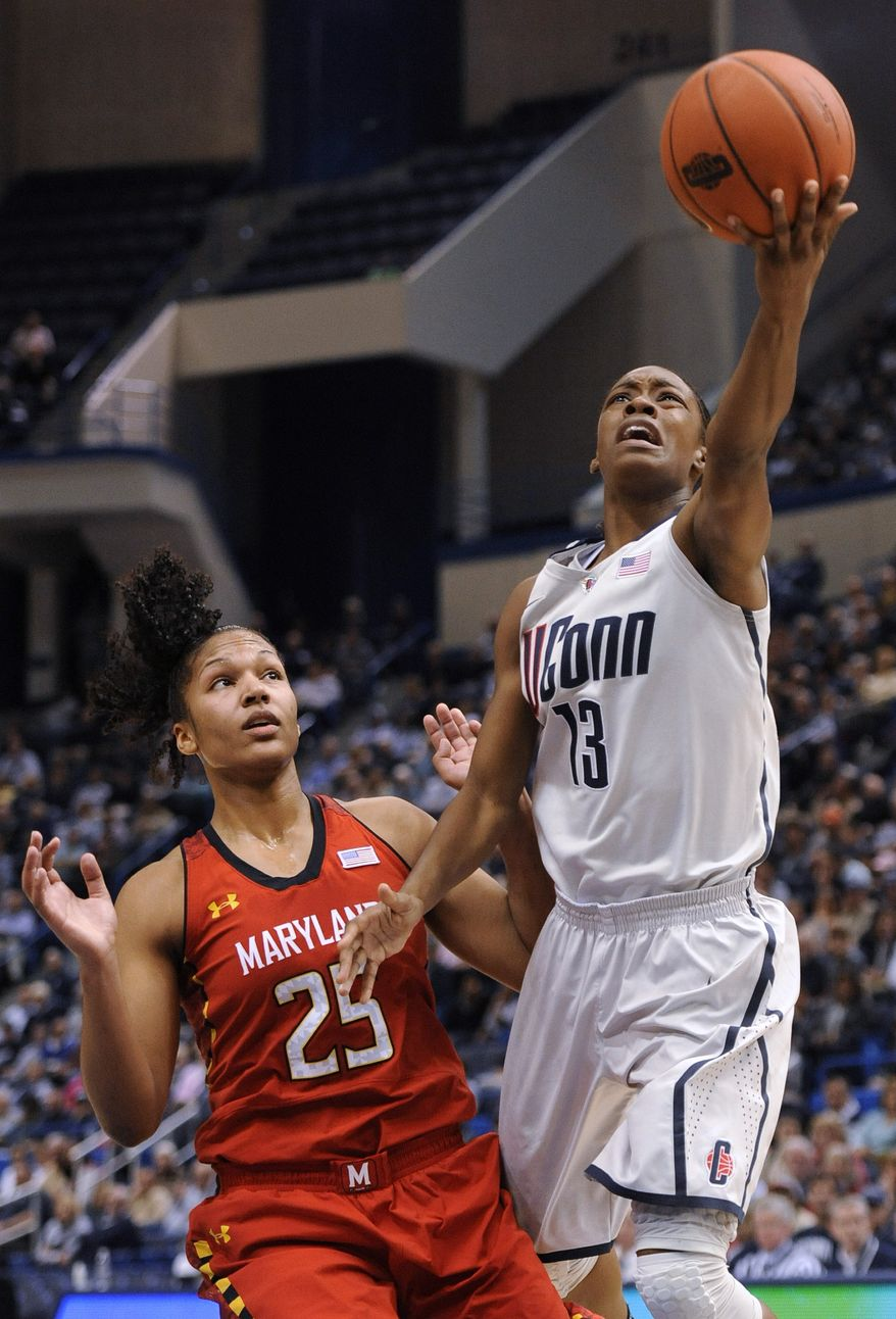 Connecticut's Brianna Banks (13) goes up for a shot while guarded by Maryland's Alyssa Thomas (25) during the first half of an NCAA college basketball game in Hartford, Conn., Monday, Dec. 3, 2012. (AP Photo/Jessica Hill)