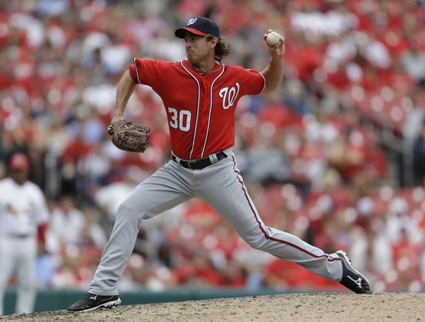 Washington Nationals pitcher Zach Duke throws during the eighth inning of a baseball game against the St. Louis Cardinals Sunday, Sept. 30, 2012, in St. Louis. (AP Photo/Jeff Roberson)