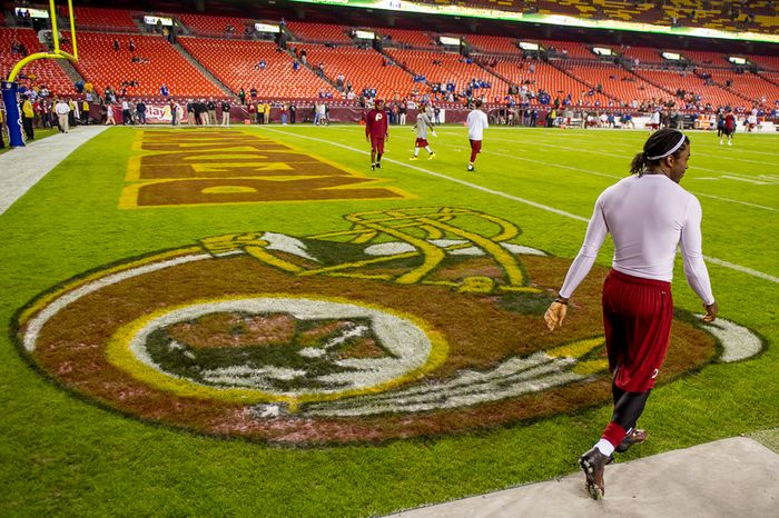 Washington Redskins quarterback Robert Griffin III (10) takes the field to warm up before the Washington Redskins play the New York Giants for Monday Night Football at FedEx Field, Landover, Md., Monday, December 3, 2012. (Andrew Harnik/The Washington Times)