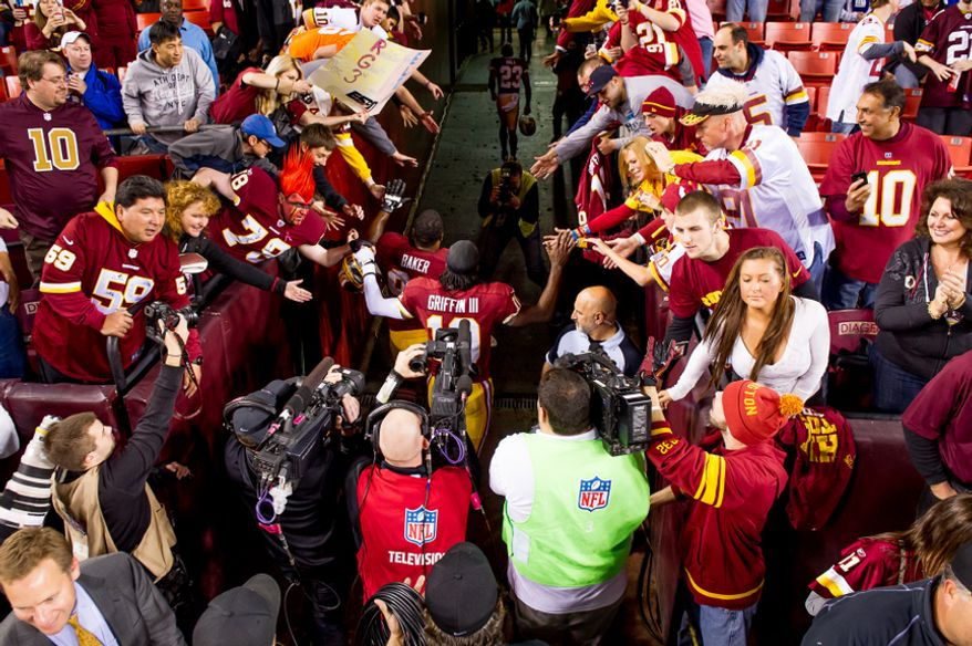Washington Redskins quarterback Robert Griffin III (10) heads back into the locker room after warms up before the Washington Redskins play the New York Giants for monday night football at FedEx Field, Landover, Md., Monday, December 3, 2012. (Andrew Harnik/The Washington Times)