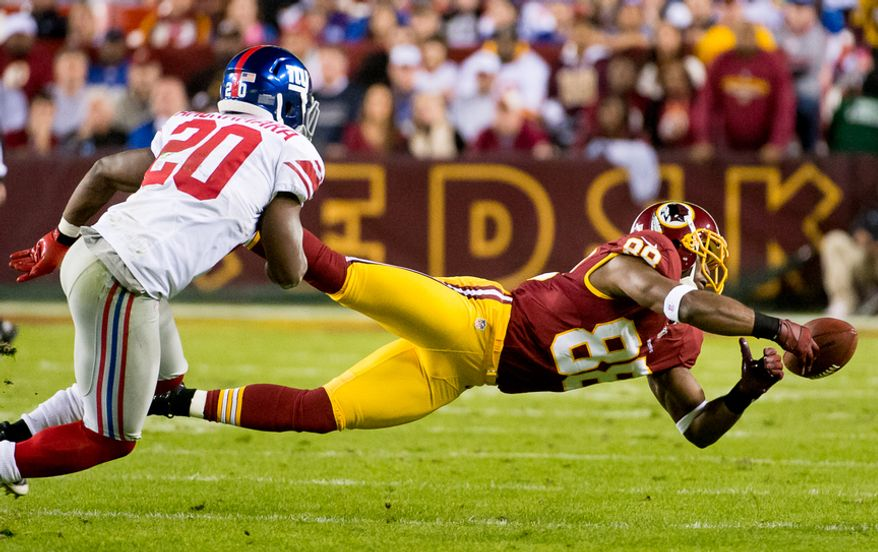 Washington Redskins wide receiver Pierre Garcon (88) can't hold onto a pass on third down in the first quarter as the Washington Redskins play the New York Giants for monday night football at FedEx Field, Landover, Md., Monday, December 3, 2012. (Andrew Harnik/The Washington Times)