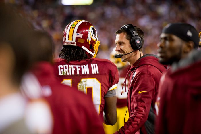 Washington Redskins quarterback Robert Griffin III (10) and Washington Redskins offensive coordinator Kyle Shanahan, right, on the sideline after Washington Redskins wide receiver Josh Morgan (15) scores on a 13 yard run off of a fumble by Washington Redskins quarterback Robert Griffin III (10) to put the Redskins up 7-3 in the first quarter as the Washington Redskins play the New York Giants for monday night football at FedEx Field, Landover, Md., Monday, December 3, 2012. (Andrew Harnik/The Washington Times)