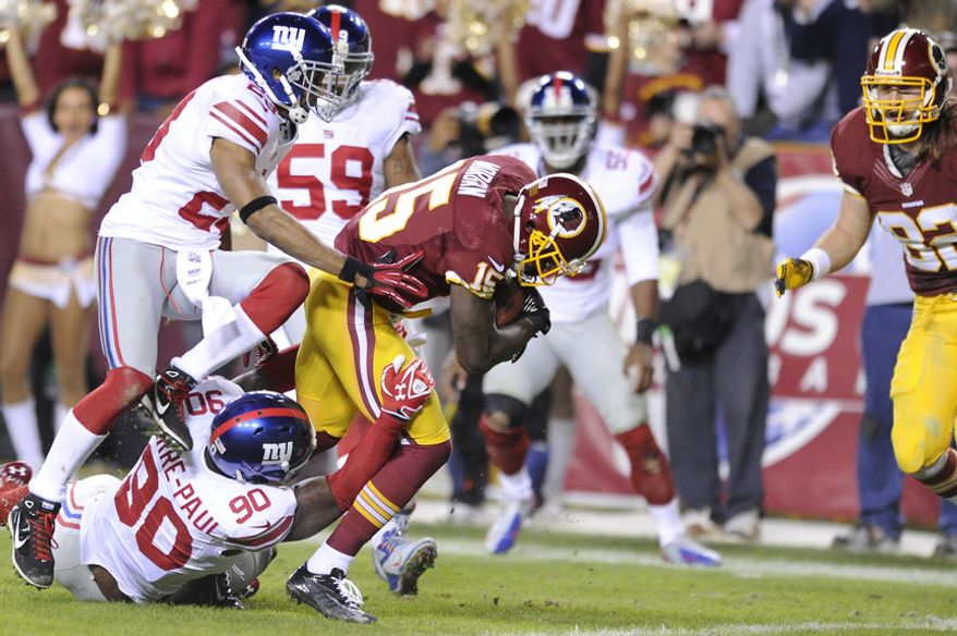 Washington Redskins wide receiver Josh Morgan (15) runs into the endzone with New York Giants defensive end Jason Pierre-Paul (90) and cornerback Corey Webster (23) in tow after recovering a fumble by quarterback Robert Griffin III in the first quarter at FedEx Field, Landover, Md., Dec. 3, 2012. (Preston Keres/Special to The Washington Times)