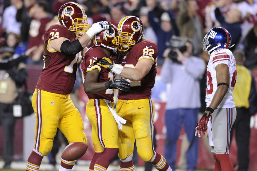 Washington Redskins wide receiver Josh Morgan  celebrates his first quarter touchdown with tackle Tyler Polumbus (74) and tight end Logan Paulsen (82) at FedEx Field, Landover, Md., Dec. 3, 2012. (Preston Keres/Special to The Washington Times)