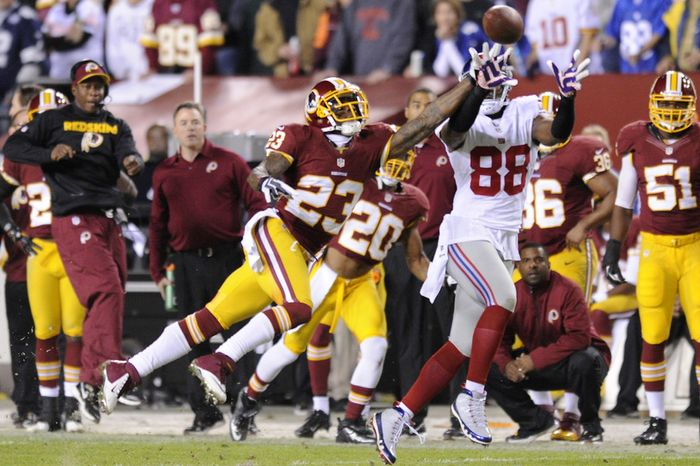 New York Giants wide receiver Hakeem Nicks (88) hauls in a first quarter pass in front of Washington Redskins cornerback DeAngelo Hall (23) at FedEx Field, Landover, Md., Dec. 3, 2012. (Preston Keres/Special to The Washington Times)