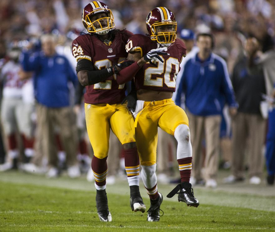 Washington Redskins defensive back Cedric Griffin (20) celebrates after breaking up a pass intended for New York Giants wide receiver Hakeem Nicks (88) in the first quarter, Landover, Md., Monday, December 3, 2012.  (Craig Bisacre/The Washington Times)