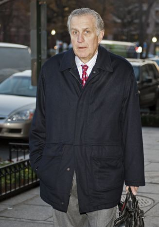 Former NFL commissioner Paul Tagliabue arrives at an attorney's office in Washington, Friday, Nov. 30, 2012, to take part in a hearing of the pay-for-pain bounty system with the New Orleans Saints. Friday's session is part of the latest round of player appeals overseen by former Tagliabue. (AP Photo/Cliff Owen)