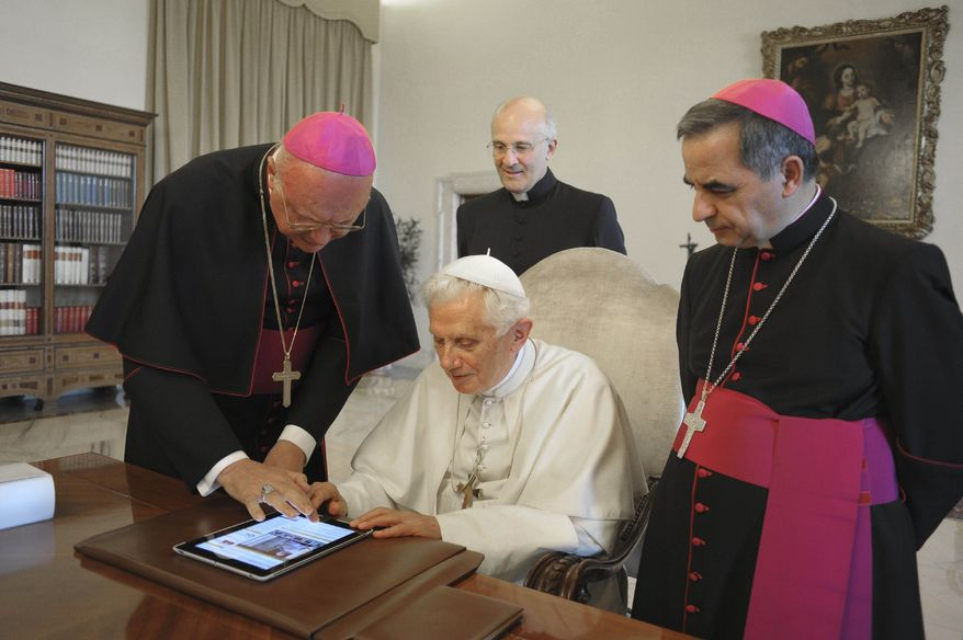 ** FILE ** Pope Benedict XVI presses a touchpad to send a tweet for the launch of the Vatican news information portal www.news.va at the Vatican on Tuesday, June 28, 2011. The pontiff will start tweeting in six languages from his own personal handle, @Pontifex, on Wednesday, Dec. 12, 2012, the Vatican announced. (AP Photo/Osservatore Romano)