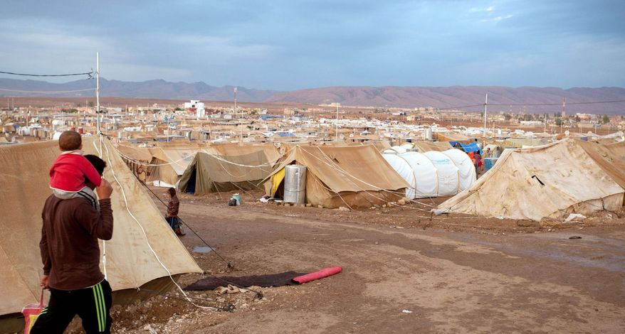 Domiz refugee camp in the Kurdish Autonomous Region of Iraq has absorbed more than 30,000 Syrian Kurds since April, housing many of them in U.N. Refugee Agency tents. (Giulio Petrocco/ Special to The Washington Times)