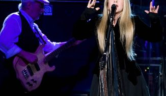John McVie and Stevie Nicks of Fleetwood Mac perform at Madison Square Garden in New York in March 2009. Fleetwood Mac is heading back on the road with a 34-city U.S. tour beginning in April. Lindsay Buckingham and Mick Fleetwood will be on hand, too, but not Christine McVie. (Associated Press)