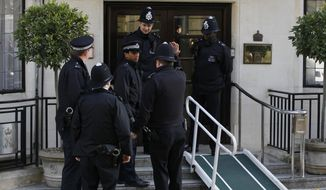 Police officers stand guard outside the King Edward VII hospital in central London on Dec. 4, 2012, where Kate, the Duchess of Cambridge, has been admitted with a severe form of morning sickness. She and her husband, Prince William, are expecting their first child, it was announced the previous day. (Associated Press)