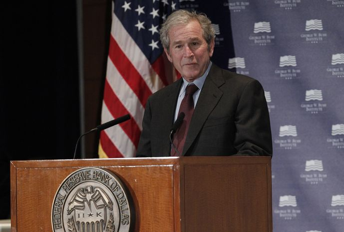 """Former President George W. Bush gives opening remarks on Dec. 4, 2012, at the Federal Reserve Bank of Dallas for a conference titled """"Immigration and 4% Growth: How Immigrants Grow the U.S. Economy."""" The George W. Bush Institute was hosting panel discussions highlighting the positive impact of immigration on U.S. economic growth. (Associated Press)"""