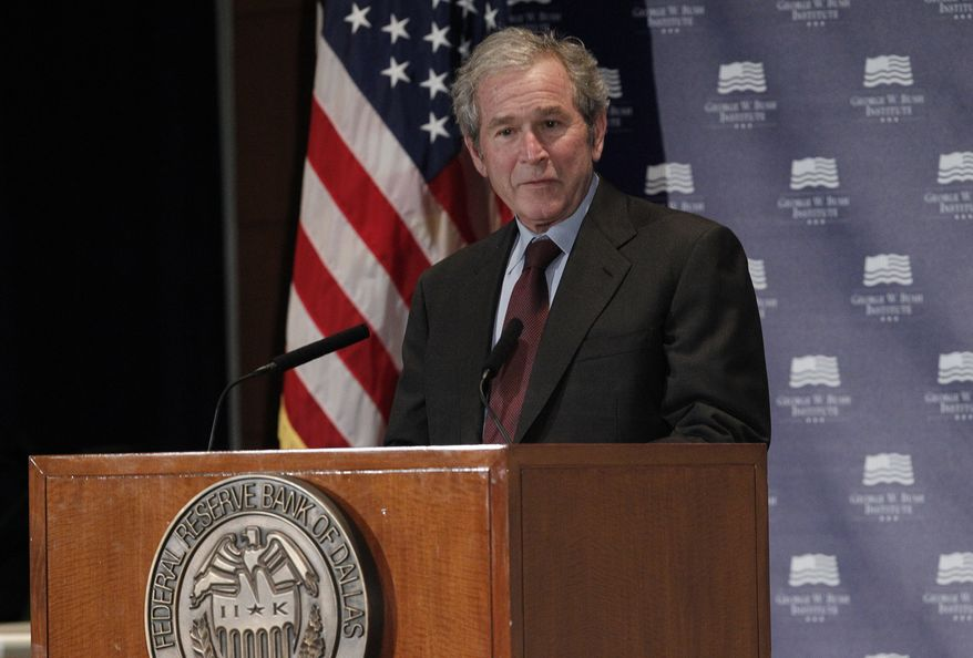 "Former President George W. Bush gives opening remarks on Dec. 4, 2012, at the Federal Reserve Bank of Dallas for a conference titled ""Immigration and 4% Growth: How Immigrants Grow the U.S. Economy."" The George W. Bush Institute was hosting panel discussions highlighting the positive impact of immigration on U.S. economic growth. (Associated Press)"