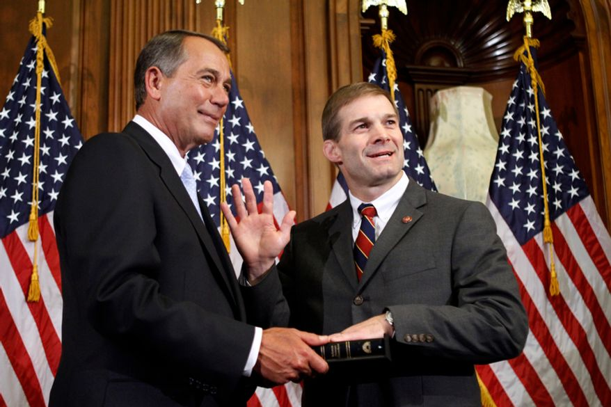 **FILE** House Speaker John Boehner, Ohio Republican, participates in a ceremonial swearing in with Rep. Jim Jordan, Ohio Republican, on Capitol Hill in Washington on Jan. 5, 2011. (Associated Press)