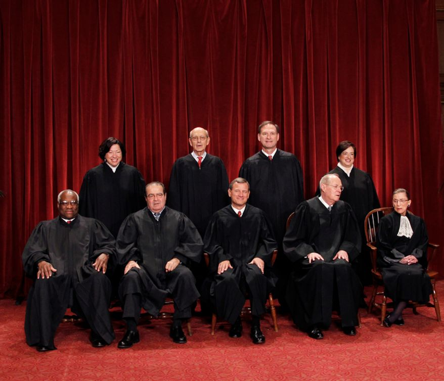**FILE** This photo shows the justices of the U.S. Supreme Court in a group portrait at the Supreme Court Building in Washington on Oct. 8, 2010. Seated from left to right are: Associate Justice Clarence Thomas, Associate Justice Antonin Scalia, Chief Justice John G. Roberts, Associate Justice Anthony M. Kennedy, Associate Justice Ruth Bader Ginsburg. Standing, from left are: Associate Justice Sonia Sotomayor, Associate Justice Stephen Breyer, Associate Justice Samuel Alito Jr., and Associate Justice Elena Kagan. (Associated Press)
