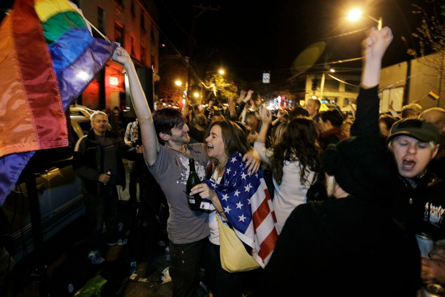 **FILE** Revelers display American and gay pride flags as they celebrate early election returns favoring Washington state's Referendum 74, which would legalize gay marriage, during a large impromptu street gathering in Seattle's Capitol Hill neighborhood in the early hours of Nov. 7, 2012. (Associated Press)