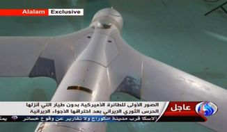 An image taken from Iranian state TV's Arabic-language channel, Al-Alam, shows what Tehran purports is an intact U.S. ScanEagle drone aircraft on Tuesday, Dec. 4, 2012. (AP Photo/Al-Alam TV)