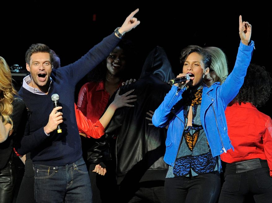 Ryan Seacrest, left, and singer Alicia Keys introduce Justin Bieber during the second night of KIIS FM's Jingle Ball at Nokia Theatre LA Live on Monday, Dec. 3, 2012, in Los Angeles. (Photo by Chris Pizzello/Invision/AP)