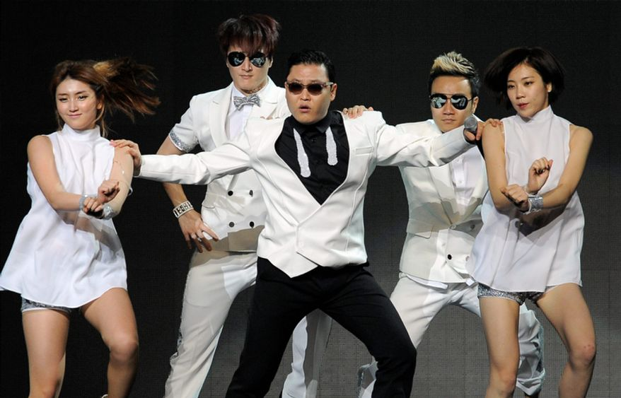 Psy, center, performs with backup dancers during the second night of KIIS FM's Jingle Ball at Nokia Theatre LA Live on Monday, Dec. 3, 2012, in Los Angeles. (Photo by Chris Pizzello/Invision/AP)