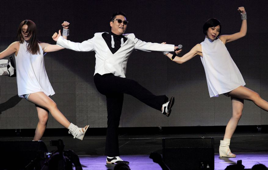 Psy, center, performs during the second night of KIIS FM's Jingle Ball at Nokia Theatre LA Live on Monday, Dec. 3, 2012, in Los Angeles. (Photo by Chris Pizzello/Invision/AP)