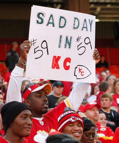 A Kansas City Chiefs fan holds a sign during the first half of the Chiefs' 27-21 win against the Carolina Panthers at Arrowhead Stadium in Kansas City, Mo., on Dec. 2, 2012. The Chiefs' ended an eight-game losing streak with the win, one day after their linebacker Jovan Belcher killed his girlfriend and himself. (Associated Press)