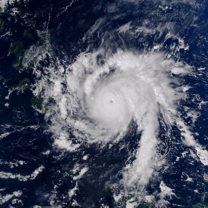 Typhoon Bopha is shown moving toward the Philippines in an Earth Observatory image from Monday, Dec. 3, 2012. (AP Photo/U.S. National Aeronautics and Space Administration, Jesse Allen)