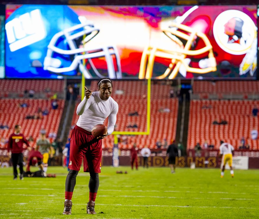 Washington Redskins quarterback Robert Griffin III (10) warms up before the Washington Redskins play the New York Giants for monday night football at FedEx Field, Landover, Md., Monday, December 3, 2012. (Andrew Harnik/The Washington Times)