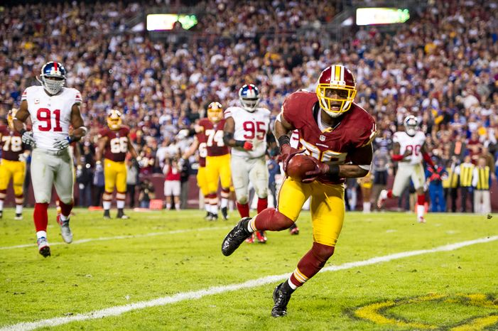 Washington Redskins wide receiver Pierre Garcon (88) catches an 8-yard touchdown in the fourth quarter as the Washington Redskins play the New York Giants on Monday Night Football at FedEx Field, Landover, Md., Dec. 3, 2012. (Andrew Harnik/The Washington Times)