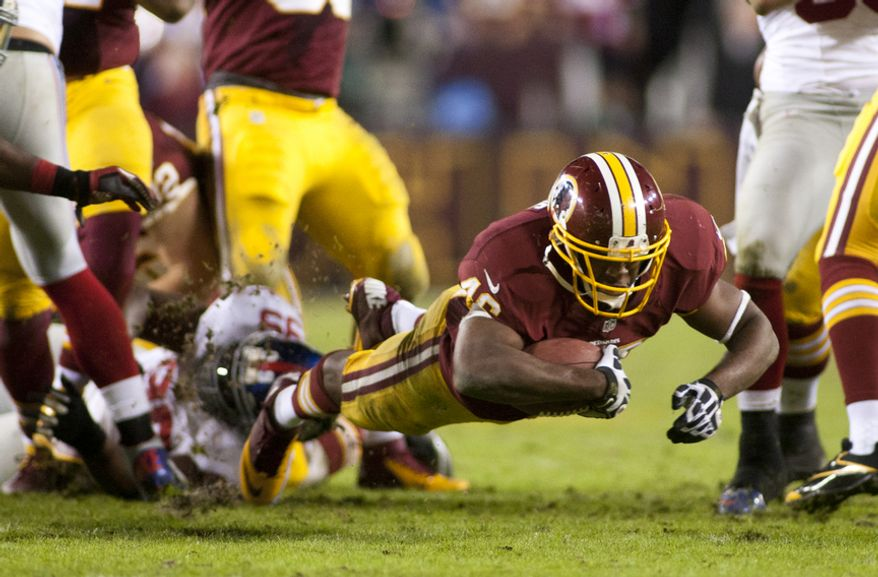 Washington Redskins running back Alfred Morris (46) dives for the first down in the final seconds to clinch the victory for the Washington Redskins over the New York Giants on Monday Night Football at FedEx Field, Landover, Md., Dec. 3, 2012.  (Craig Bisacre/The Washington Times)