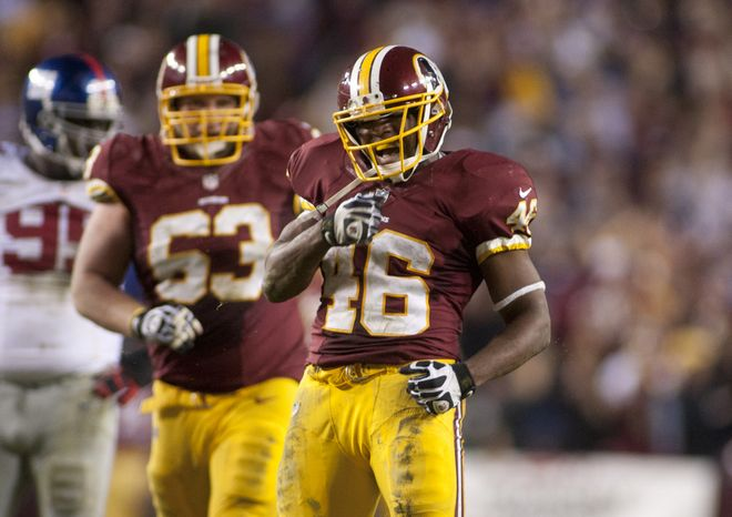Washington Redskins running back Alfred Morris (46) celebrates after getting the first down in the final seconds against the New York Giants, Landover, Md., Monday, Dec. 3, 2012.  (Craig Bisacre/The Washington Times)