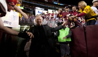 Joe Gibbs walks on the field before the start of Monday night's Washington Redskins against the New York Giants, Landover, Md., Monday, December 3, 2012.  (Craig Bisacre/The Washington Times)