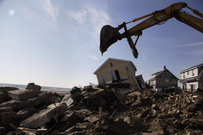 **FILE** Cleanup continues Nov. 29, 2012, on the site of a demolished home on the Rockaway Peninsula in New York. Superstorm Sandy damaged or destroyed 305,000 housing units in New York. (Associated Press)