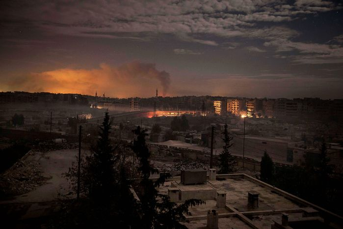 Smoke rises from buildings during heavy fighting between Free Syrian Army fighters and government forces in Aleppo, Syria, on Saturday, Dec. 1, 2012. (AP Photo/Narciso Contreras)