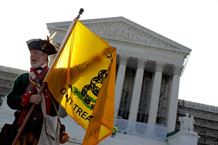 ** FILE ** Tea party supporter William Temple of Brunswick, Ga., protests President Obama's health care law outside the U.S. Supreme Court in Washington on Thursday, June 28, 2012. (AP Photo/David Goldman)