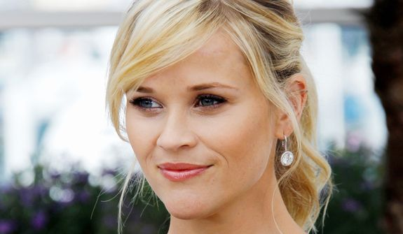 """** FILE ** This May 26, 2012 photo shows actress Reese Witherspoon posing during a photo call for """"Mud"""" at the 65th international film festival, in Cannes, southern France. The 36-year-old Oscar winner and mother of three will receive the March of Dimes Grace Kelly Award at its Celebration of Babies luncheon Friday Dec. 7, 2012 at the Beverly Hills Hotel. (AP Photo/Joel Ryan)"""