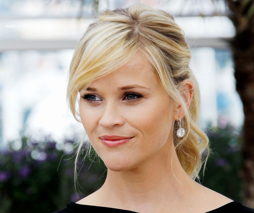 "** FILE ** This May 26, 2012 photo shows actress Reese Witherspoon posing during a photo call for ""Mud"" at the 65th international film festival, in Cannes, southern France. The 36-year-old Oscar winner and mother of three will receive the March of Dimes Grace Kelly Award at its Celebration of Babies luncheon Friday Dec. 7, 2012 at the Beverly Hills Hotel. (AP Photo/Joel Ryan)"