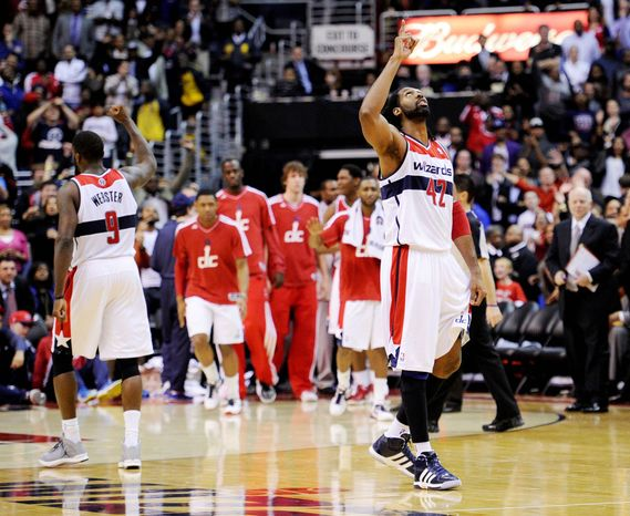 Wizards center Nene (42) and Martell Webster (9) had reason to celebrate after Tuesday's win over NBA-champion Miami gave Washington just its second win in 15 games. (Associated Press)