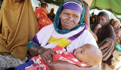 Amina Abdi and her child live in a tent on the outskirts of Mogadishu, Somalia, in a camp that provides no services or security to protect women from rape. (Associated Press)