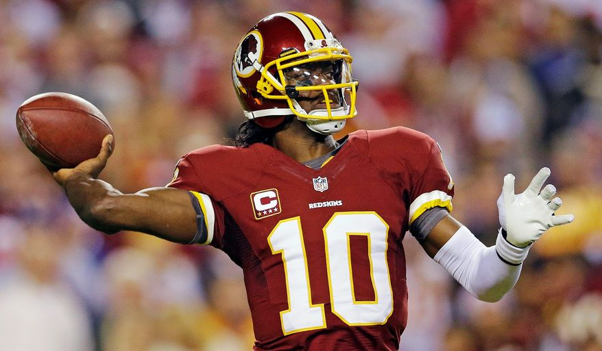 """Robert Griffin III looked """"better"""" in practice Thursday, but he's still """"probably"""" going to be a game-time decision Sunday, according to Redskins coach Mike Shanahan. (Associated Press)"""