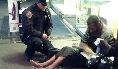 Officer Lawrence DePrimo helping Mr. Hillman/ Associated Press