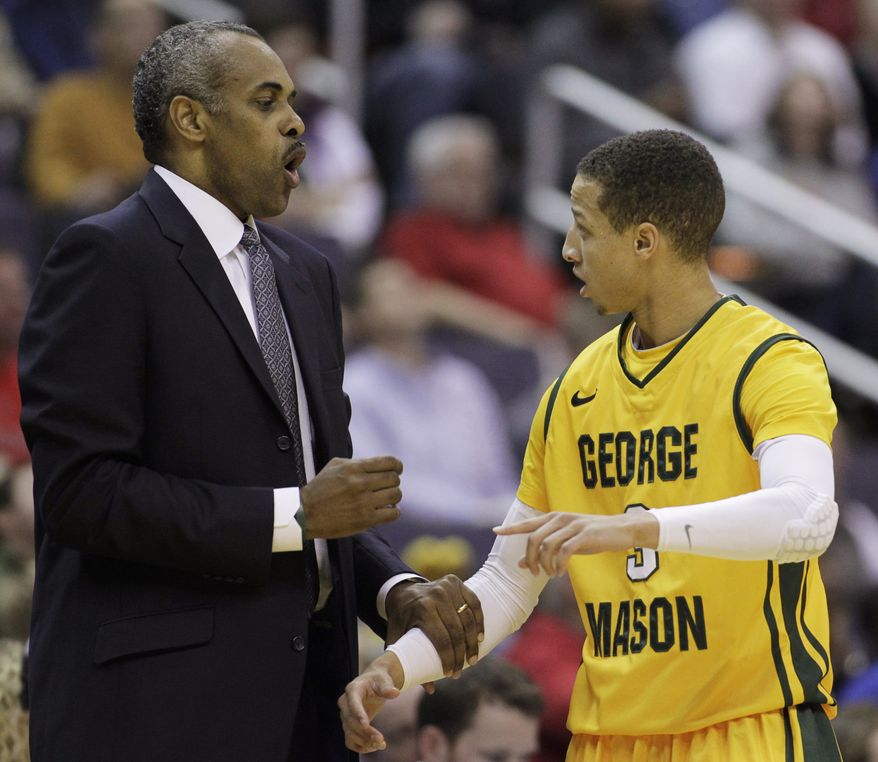 George Mason head coach Paul Hewitt, left, talks to Patrick Holloway during the first half of an NCAA college basketball game against Maryland at the 18th Annual BB&T Classic in Washington, Sunday, Dec. 2, 2012. Maryland won 69-62. (AP Photo/Luis M. Alvarez)