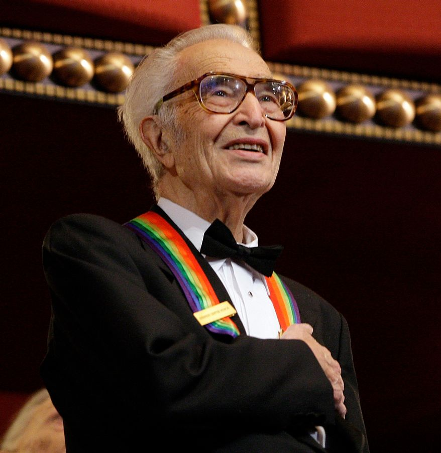 In this Dec. 6, 2009 file photo, Kennedy Center honoree Dave Brubeck stands for the National Anthem at the Kennedy Center Honors gala in Washington.  Brubeck, a pioneering jazz composer and pianist died Wednesday, Dec. 5, 2012 of heart failure, after being stricken while on his way to a cardiology appointment with his son. He would have turned 92 on Thursday.   (AP Photo/Alex Brandon, File)