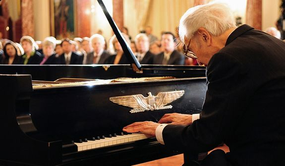 "In this photo provided by the State Department, Legendary jazz pianist Dave Brubeck, 87, stands after performing his improvisational piece ""Dziekuje"" (""Thank you,"" in Polish) for an audience at the State Department Tuesday, April 8, 2008. Brubeck was honored by Secretary of State Condoleezza Rice for a half-century of service as a public diplomacy envoy, 50 years after making his first trip to then-communist eastern Europe to promote American ideals through jazz. ""Jazz was the voice of freedom and it still is,"" Brubeck said after the ceremony. Rice said she had grown up on Brubeck's music ""because my dad was your biggest fan. I want to thank you for your patriotism and your leadership in representing America by introducing the language, the sounds and the spirit of jazz to new generations around the world."" (AP Photo/State Department, Michael Gross)"