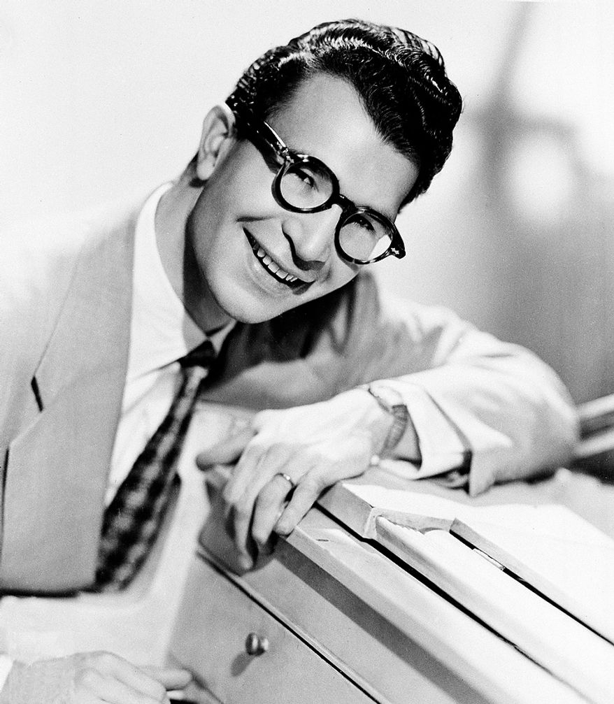 """This 1956 file photo shows Dave Brubeck, American composer, pianist and jazz musician. Brubeck, who turns 90 on Monday, Dec. 6, 2010, will celebrate the day by gathering in the family home in the Connecticut woods to watch Turner Classic Movies broadcast """"Dave Brubeck: In His Own Sweet Way,"""" a new documentary directed by Bruce Ricker, produced by Clint Eastwood and narrated by Alec Baldwin. (AP Photo/File)"""
