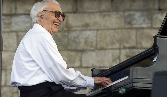 Dave Brubeck performs with his band, The Dave Brubeck Quartet, at the JVC Jazz Festival in Newport, R.I., Sunday, Aug. 10, 2003. (AP Photo/Stew Milne)