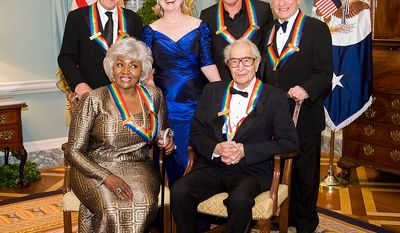 The 2009 Kennedy Center Honorees Robert De Niro, left; Grace Bumbry, bottom left, Dave Brubeck, bottom right; Bruce Springsteen, second from right; and Mel Brooks, right, pose with Secretary of State Hillary Rodham Clinton for a photo at the State Department following the Kennedy Center Honors Gala Dinner on Saturday, Dec. 5, 2009 in Washington. (AP Photo/Kevin Wolf)