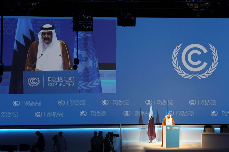 "Qatari Emir, Sheikh Hamad bin Khalifa Al-Thani addresses the opening of the high-level segment of the annual U.N. climate talks involving environment ministers and climate officials from nearly 200 countries, in Doha, Qatar, Tuesday, Dec. 4, 2012. U.N. Secretary-General Ban Ki-moon has urged governments to speed up slow-moving talks to forge a joint response to global warming and warned that climate change was a ""crisis, a threat to us all, our economies, our security and the well-being of our children."" (AP Photo/Osama Faisal)"