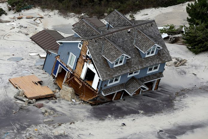 ** FILE ** This Wednesday, Oct. 31, 2012, file aerial photo shows a collapsed house along the central Jersey Shore coast. (AP Photo/Mike Groll, File)