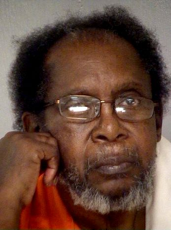 Frank Louis Reeves, of Macon, Ga., seen here in a photo by the Bibb County (Ga.) Jail, was arrested for shooting and killing 65-year-old Linda Hunnicutt on Dec. 4, 2012, at a gas station after her vehicle bumped into Reeves' motorized wheelchair, authorities said. (Associated Press/Bibb County Jail)