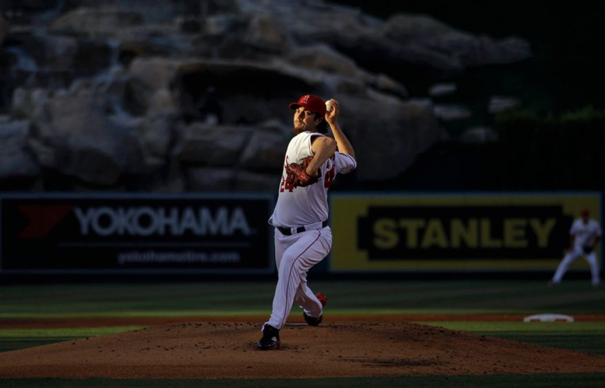 Los Angeles Angels starting pitcher Dan Haren throws to a Los Angeles Dodgers batter during the first inning of a baseball game in Anaheim, Calif., Friday, June 22, 2012. (AP Photo/Jae C. Hong)
